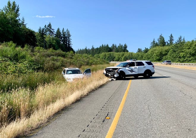 A Washington State Patrol vehicle collided with a white sedan Friday afternoon on Highway 3. The sedan had been traveling the wrong way in the northbound lane of the highway.