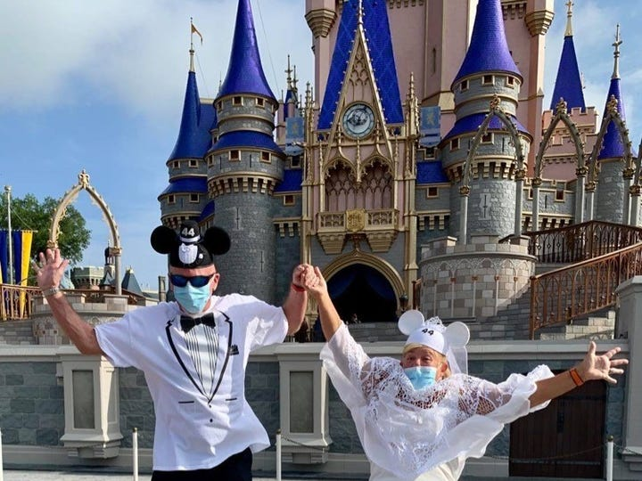 Steve and Carol Show of Port St. Lucie celebrate their 44th wedding anniversary at Walt Disney World's Magic Kingdom, which reopened to the public Saturday.