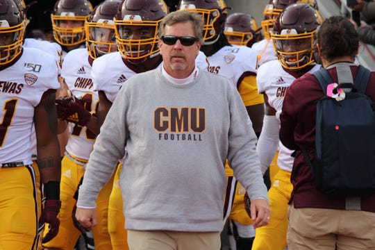 Central Michigan football coach Jim McElwain walks his team out to the field Oct. 26, 2019, before playing Buffalo at UB Stadium in Buffalo, New York.