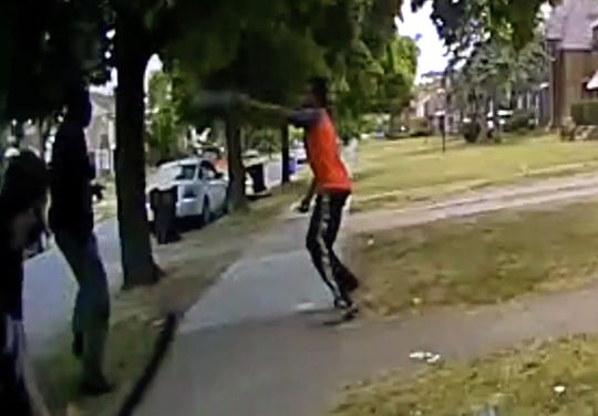In this frame grab from body camera video provided by the Detroit Police Department shows the suspect allegedly firing on officers as they were attempting to arrest another subject.