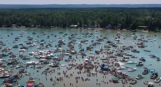 Hundreds of boaters gather at the annual Torch Lake sandbar boat party on the Fourth of July in Northern Michigan.