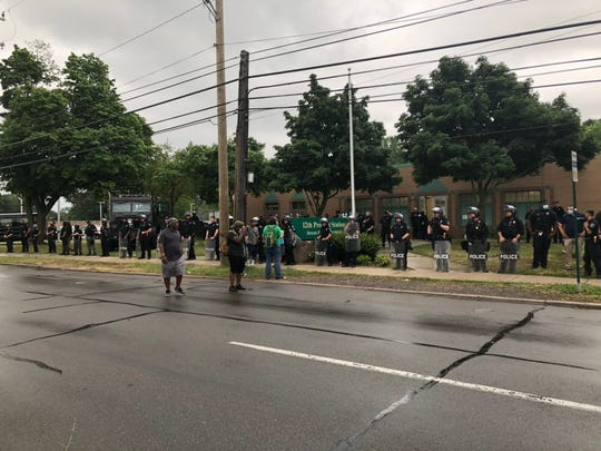 Detroit police officers line up outside the 12th Precinct headquarters during a protest over officers' fatal shooting of a man Friday, July 10, 2020.
