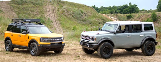 The 2021 Ford Bronco Sport, left, and Bronco four-door are pictured together at the Holly Oaks ORV Park on Friday.