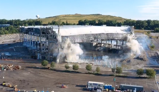 The roof of the Palace collapses as the supports are blown out below during the demolition.