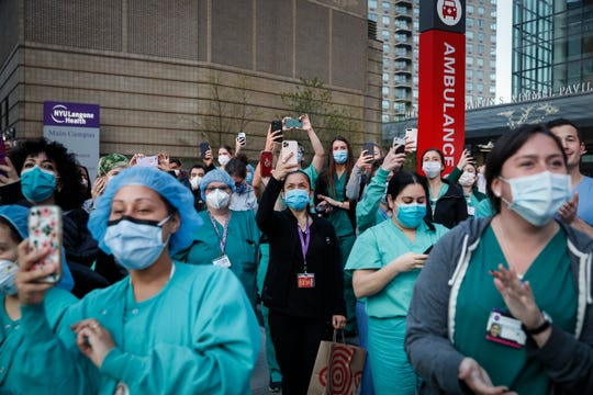 Medical personnel attend a daily 7 p.m. applause in their honor April 28, during the coronavirus pandemic outside NYU Langone Medical Center in the Manhattan borough of New York.