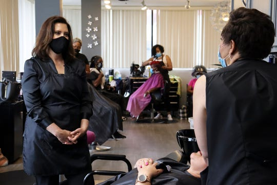 "Michigan Gov. Gretchen Whitmer visits Reflections Hair Salon in Grand Rapids during her ""Work with Whitmer"" tour on Friday, June 26, 2020."