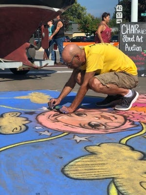 2019 featured Chalk the Bay artist John Soukup at work in front of On Deck in downtown Sturgeon Bay.