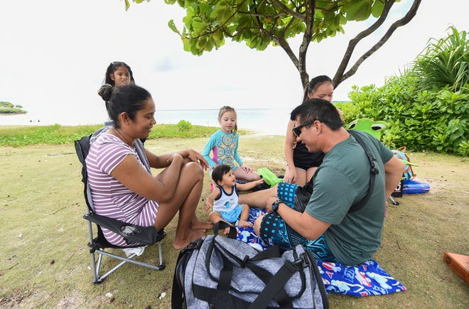 Families and friends were at the Gov. Joseph Flores Beach Park in Tumon, July 11, 2020. A maximum of 25 people are allowed to gather in one location during Pandemic Condition of Readiness 2.