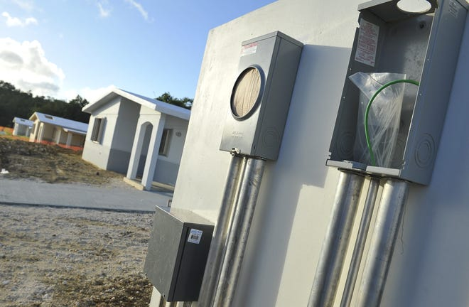 Power meter boxes await the installation of wires in this file photo. Delinquent customers are being asked to visit the Guam Power Authority to create a payment plan.