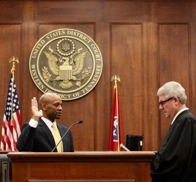 Tyreece Miller is sworn in as U.S. Marshal by Chief District Judge S. Thomas Anderson in the federal courtroom in Jackson on Friday, July 10, 2020.