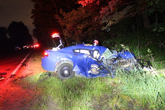 A Michigan State Police trooper and a 28-year-old woman were injured in a collision Friday, July 10, 2020 in Ionia County.