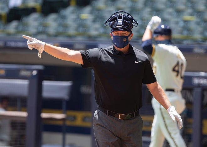Minor-league instructor Charlie Greene has been called on to umpire the Brewers' intrasquad games during summer camp at Miller Park.
