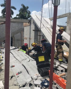 Two construction workers were injured after a crane with its load collapsed on top of them in Naples on July 11, 2020, according to the Naples Fire-Rescue Department.