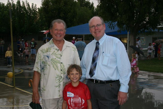 Former California Assemblyman Bruce Nestande, left, and Riverside County Supervisor John Benoit join second-grader Brett Nestande (Bruce Nestande's grandson) at Desert Christian Academy's WATCH D.O.G.S. event in 2011. WATCH D.O.G.S. (Dads of Great Students) is the father-involvement initiative of the National Center for Fathering that organizes fathers and father figures in order to provide positive male role models for the students and to enhance school security.