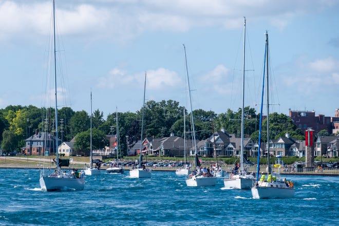 Sailboats head toward Lake Huron before the start of the Port Huron-to-Mackinac Race Saturday, July 11, 2020, in Port Huron.