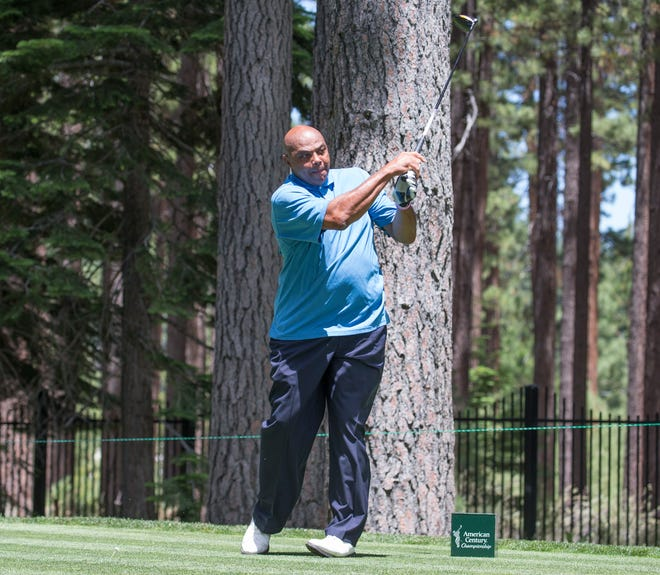 Charles Barkley hits a tee shot during the ACC Golf Tournament at Edgewood Tahoe Golf Course in South Lake Tahoe on Friday, July 10, 2020.