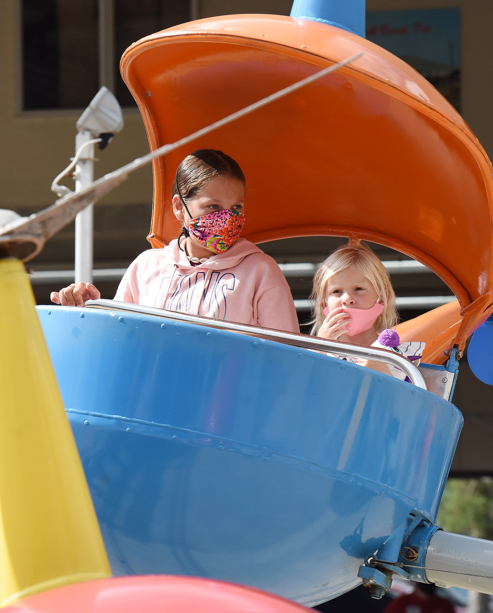 A mother and daughter riding a flat ride at Funland.