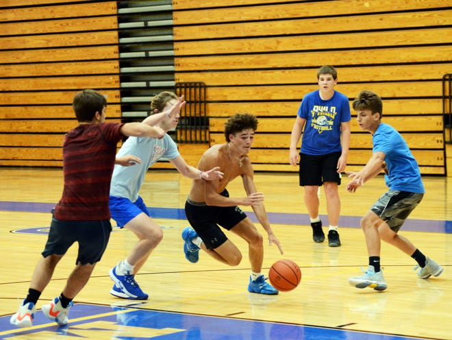 Philo junior Jaxson Radcliffe drives into the lane during an open gym session last Wednesday at The Power Plant. The Electrics are among local programs trying to make the most of limited summer practice time.