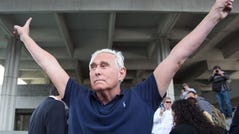 (FILES) In this file photo taken on January 25, 2019 Roger Stone, a longtime adviser to US President Donald Trump, throws up peace signs outside court in Fort Lauderdale, Florida. - US President Donald Trump communted the 40-month prison sentence of longtime ally Roger Stone on July 10, 2020, the White House said. (Photo by Joshua Prezant / AFP) (Photo by JOSHUA PREZANT/AFP via Getty Images) ORIG FILE ID: AFP_1UZ42F