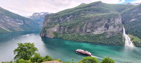 This ship makes its way through Norway's famed Geirangerfjord.
