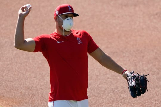 A masked Mike Trout is among the MLB players who have expressed concern about playing the season with the enraged coronavirus.
