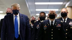 President Donald Trump wears a face mask during a visit to Walter Reed National Military Medical Center in Bethesda, Maryland, on Saturday.