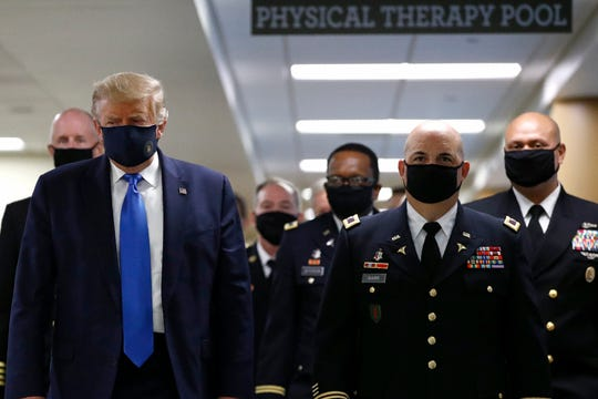 President Donald Trump wears a face mask during a visit to the Walter Reed National Military Medical Center in Bethesda, Md., On July 11.