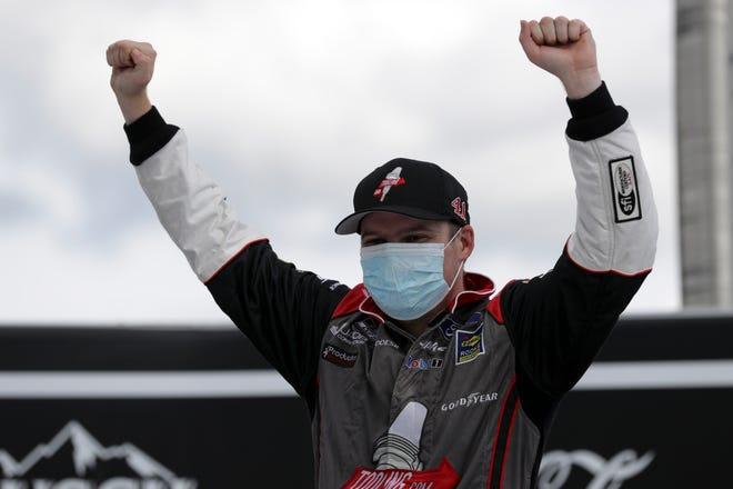 Cole Custer celebrates after winning a NASCAR Cup Quaker State 400 at Kentucky Speedway. MARK HUMPHREY/AP