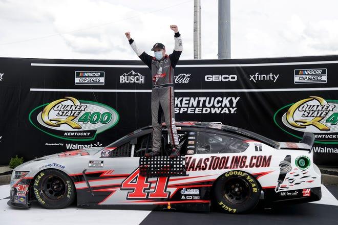 Cole Custer (41) celebrates after winning a NASCAR Cup Quaker State 400 at Kentucky Speedway. MARK HUMPHREY/AP