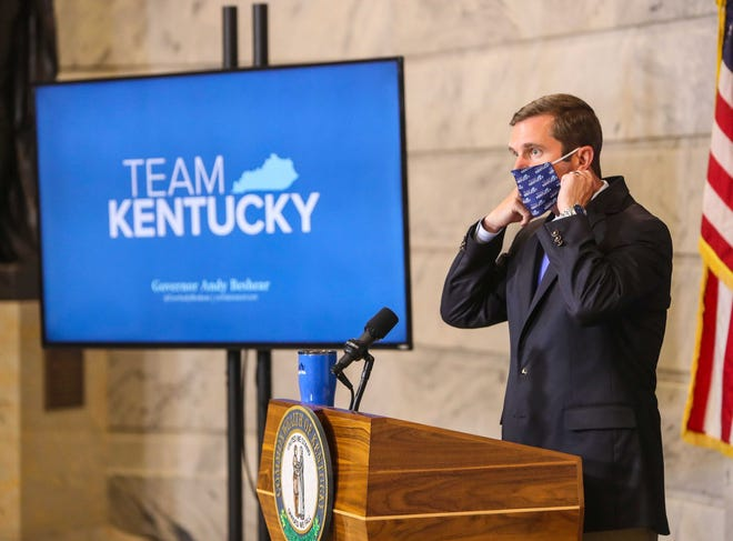 Kentucky Gov. Andy Beshear wears a mask.