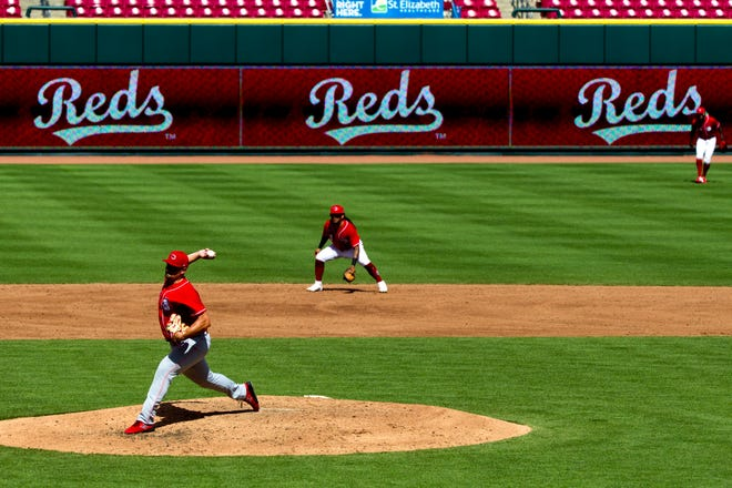 Cincinnati Reds relief pitcher Joel Kuhnel (66) throws a pitch during the Reds spring scrimmage at Great American Ball Park on Sunday, July 12, 2020, in Cincinnati.