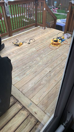 Michael Delardo's deck with new wood slabs.