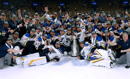The St. Louis Blues celebrate with the Stanley Cup after they defeated the Boston Bruins in Game 7 of the 2019 NHL Finals.