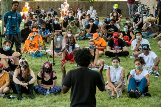 Activist Tristan Taylor speaks to dozens of people gathered at the Butzel Family Recreation Center, in Detroit July 12, 2020, to protest police brutality in the wake of the shooting death of 19-year-old Hakim Littleton. Littleton was killed by police, July 10 after he shot at officers making the arrest of another individual.
