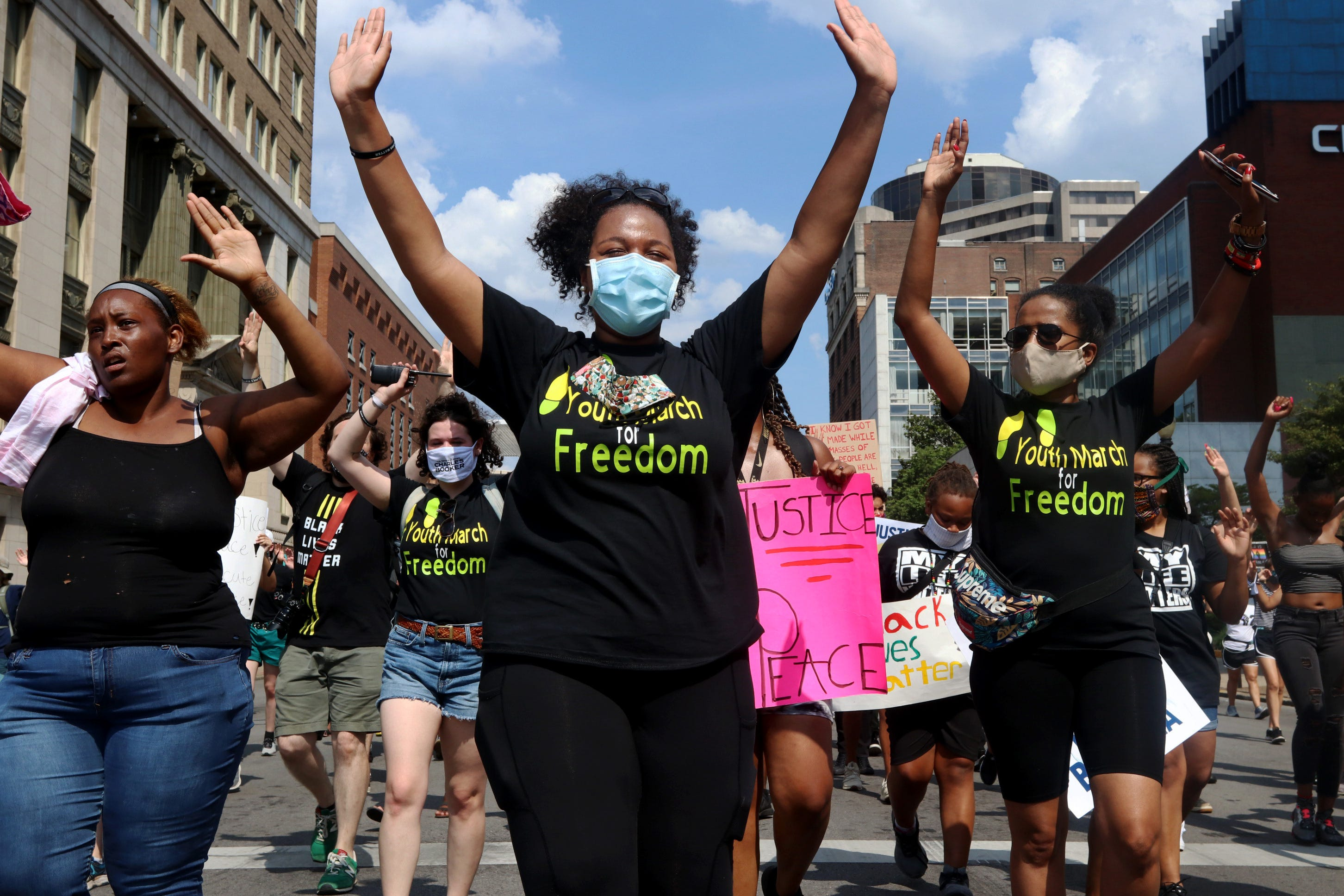 Imani Smith, 19, center, helps lead the Youth March for Freedom on July 4, 2020 in Louisville, Ky.