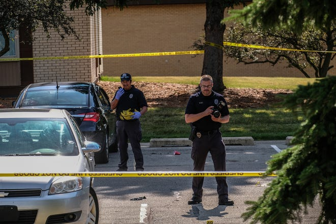 Lansing Police Crime Scene investigators at the scene of a shooting at the Towne Square Apartments on the corner of Jolly and Dunckel roads Sunday, July 12, 2020. Five people were wounded and were in stable condition Sunday.
