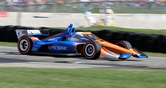 Scott Dixon  is a blur of speed as he exits Turn 5 during the REV Group Grand Prix first race July 11, 2020, at Elkhart Lake's Road America.
