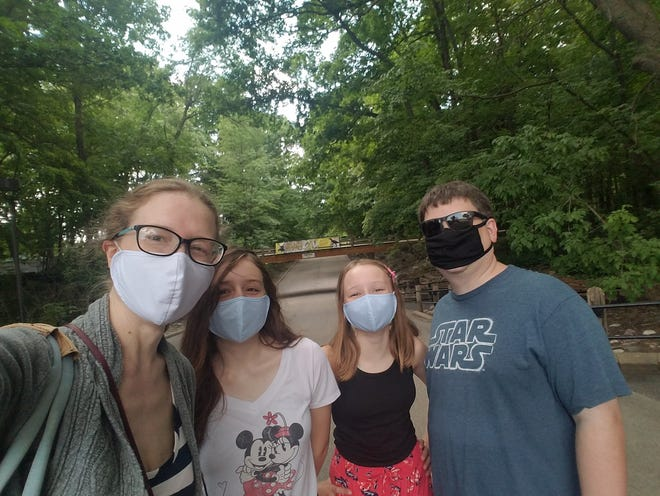 Amy Schwabe, her daughters, Alex and Wendy, and husband, Jonathan, went to the Milwaukee County Zoo soon after it reopened with pandemic precautions.