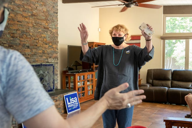 Palm Springs City Councilwoman Lisa Middleton waves to supporters that came to her home to place their signature on a form for her reelection campaign in Palm Springs, Calif., on Saturday, July 11, 2020.