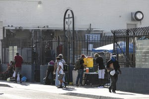 People experiencing homelessness outside of Andre House.