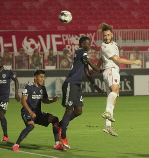 Phoenix Rising's Joe Farrell (15) goes for a header against LA Galaxy II's Augustine Williams (48) during the first half at Casino Arizona Field in Tempe, Ariz. on July 11, 2020.