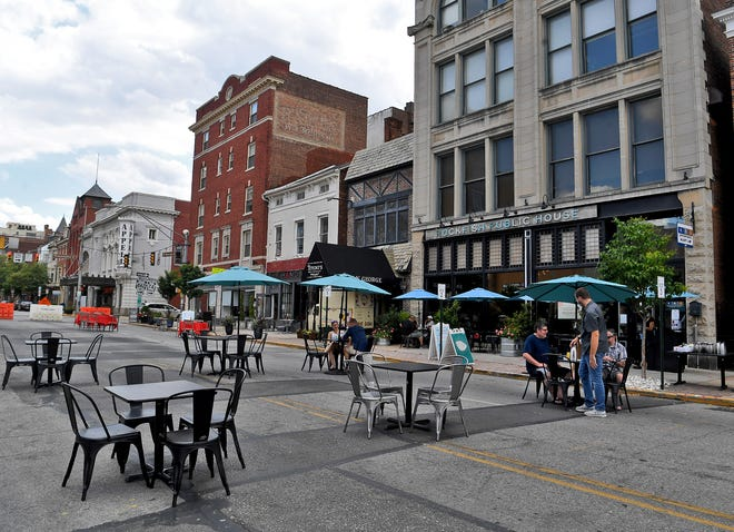 Restaurants in the 100 block of North George Street moved their seating to the street, Sunday, July 12, 2020. From July 10 through September 7, the block will be closed to vehicle traffic Friday 5:30 p.m. to closing and Saturday and Sunday 1 p.m. till closing.