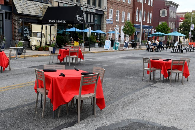 Restaurants in the 100 block of North George Street moved their seating to the street, Sunday, July 12, 2020. From July 10 through September 7, the block will be closed to vehicle traffic Friday 5:30 p.m. to closing and Saturday and Sunday 1 p.m. till closing.John A. Pavoncello photo