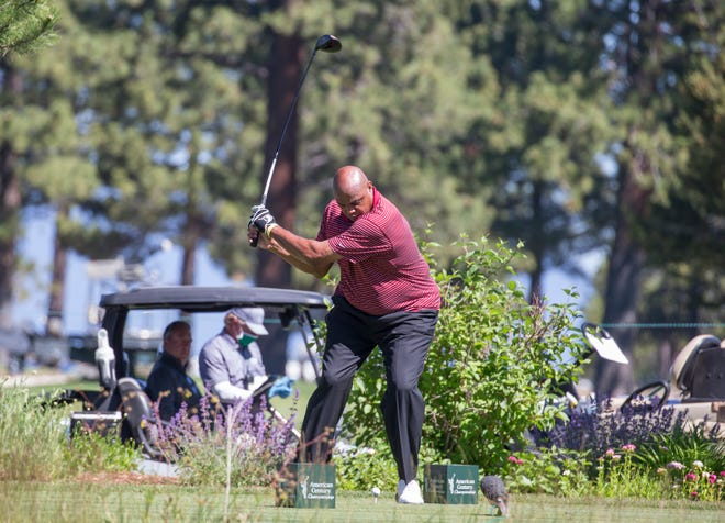 Charles Barkley tees off during the ACC Golf Tournament at Edgewood Tahoe Golf Course in South Lake Tahoe on Saturday, July 11, 2020.