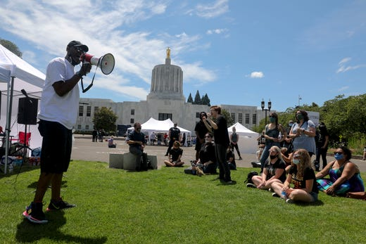William Jones speaks to the crowd during the War on Racism rally at the Oregon State Capitol, in Salem, Oregon, on Saturday, July 11, 2020.
