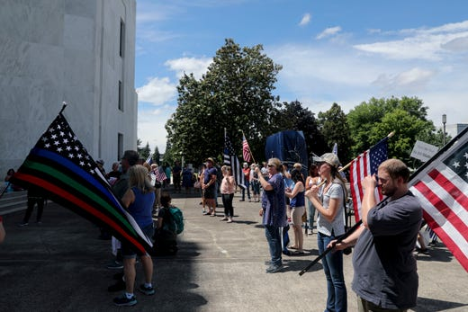 People listen as Joey Nations speaks during a Back the Blue rally at the Oregon State Capitol, in Salem, Oregon, on Saturday, July 11, 2020.