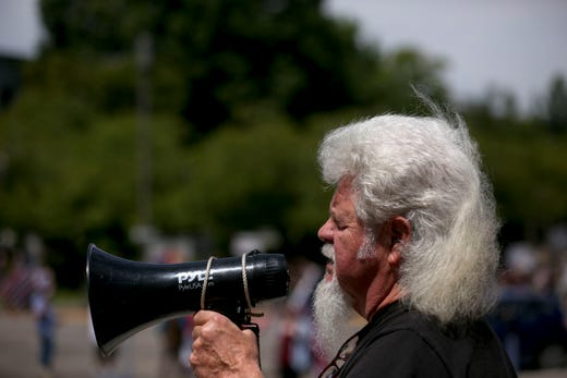 """Jim Cropper performs an original song, """"God Bless the Blue"""" during the Back the Blue rally at the Oregon State Capitol, in Salem, Oregon, on Saturday, July 11, 2020."""