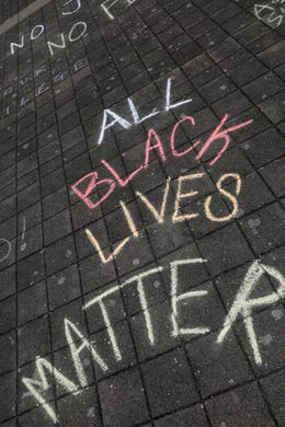 Chalk drawings are seen during the War on Racism rally at the Oregon State Capitol, in Salem, Oregon, on Saturday, July 11, 2020.