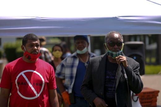 Gregg Simpson and Greg Peterson speak to the crowd during the War on Racism rally at the Oregon State Capitol, in Salem, Oregon, on Saturday, July 11, 2020.