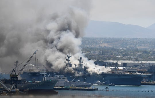 Smoke rises from the USS Bonhomme Richard at Naval Base San Diego in July.